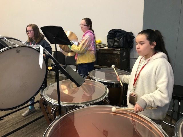 7th Grade Percussionists Kenlee Holman, Lillian Keller, and Madison Perez rehearsing for OU Honor Band